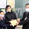 中津川市 東小学校より共同募金を頂きました。